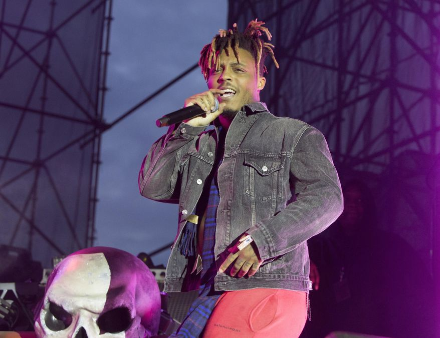 "In this May 15, 2019, file photo, Juice WRLD performs in concert during his ""Death Race for Love Tour"" at The Skyline Stage at The Mann Center for the Performing Arts in Philadelphia. The Chicago-area rapper, whose real name is Jarad A. Higgins, was pronounced dead Dec. 8 after a ""medical emergency'' at Chicago's Midway International Airport, according to authorities. (Photo by Owen Sweeney/Invision/AP, File)"