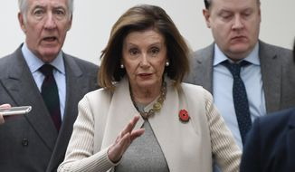 House Speaker Nancy Pelosi of Calif., center, walks on Capitol Hill in Washington, Tuesday, Dec. 17, 2019, following a meeting with Democrats. House Ways and Means Chairman Rep. Richard Neal, D-Mass., follows second from left. (AP Photo/Susan Walsh)
