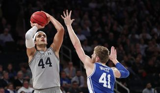 Georgetown center Omer Yurtseven (44) shoots as Duke forward Jack White (41) defends during the second half of an NCAA college basketball game in the 2K Empire Classic, Friday, Nov. 22, 2019 in New York. Duke won 81-73. (AP Photo/Kathy Willens) **FILE**