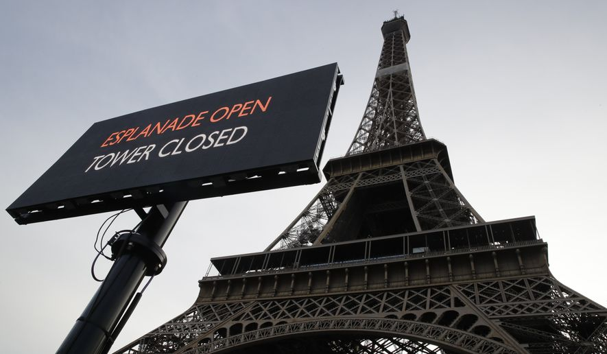 A screen announces the closure of the Eiffel Tower, Tuesday Dec.17, 2019 in Paris on the 13th straight day of traffic headaches. Teachers, doctors, lawyers and workers at the Eiffel Tower _ people from across the French workforce walked of the job Tuesday to resist a higher retirement age, or to preserve a welfare system they fear their business-friendly president wants to dismantle. (AP Photo/Christophe Ena)