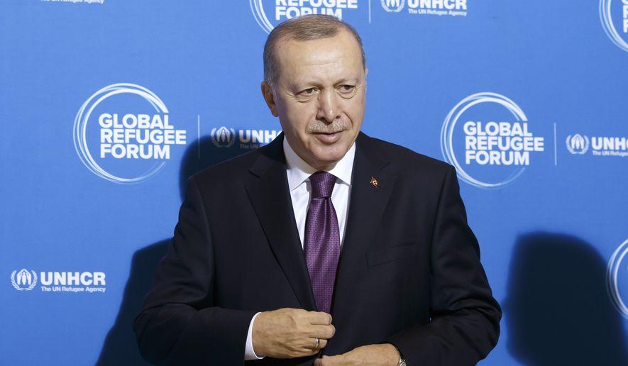 Turkey's President Recep Tayyip Erdogan arrives for the UNHCR - Global Refugee Forum at the European headquarters of the United Nations in Geneva, Switzerland, Tuesday, Dec. 17, 2019. (Salvatore Di Nolfi/Keystone via AP)