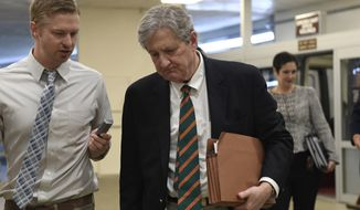 Sen. John Kennedy, R-La., walks on Capitol Hill in Washington, Tuesday, Dec. 17, 2019. (AP Photo/Susan Walsh)