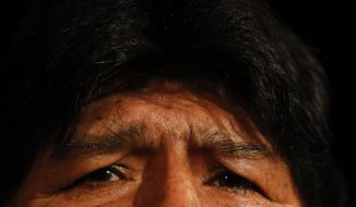 Bolivia's former President Evo Morales gives a press conference in Buenos Aires, Argentina, Tuesday, Dec. 17, 2019. Morales flew to Argentina, where the new center-left government said on Dec. 12 that it had granted him political asylum. (AP Photo/Natacha Pisarenko)