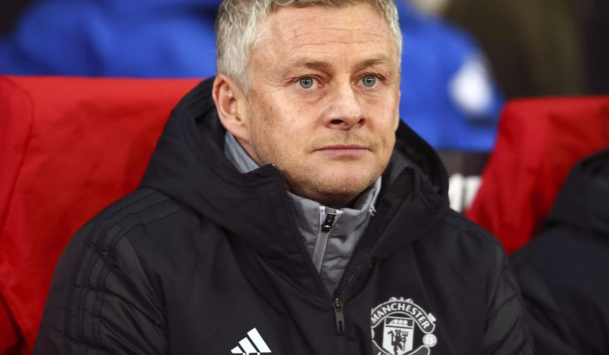 Manchester United manager Ole Gunnar Solskjaer looks on during the Europa League group L soccer match between Manchester United and AZ Alkmaar at Old Trafford in Manchester, England, Thursday, Dec. 12, 2019. (AP Photo/Dave Thompson)