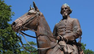 FILE - In this Aug. 18, 2017, file photo, a statue of Confederate Gen. Nathan Bedford Forrest sits in a park in Memphis, Tenn. A Tennessee nonprofit group has handed over statues of Confederate leaders Nathan Bedford Forrest and Jefferson Davis to the Sons of Confederate Veterans, two years after they were removed from public parks in Memphis, officials said Tuesday, Dec. 17, 2019. (AP Photo/Adrian Sainz, File)