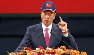 FILE - FILE - In this Feb. 2, 2019, file photo, Chairman of Hon Hai Precision Industry Co. Ltd., also known as Foxconn, Terry Gou delivers a speech during the company's annual carnival for employees in Taipei, Taiwan. A new audit says Wisconsin's economic development agency needs to modify procedures to ensure tax credits aren't awarded for Foxconn Technology Group employees who don't do work in the state. The nonpartisan Legislative Audit Bureau released its findings Tuesday, Dec. 17, 2019, and it's the second year that the audit has identified this problem. (AP Photo/Chiang Ying-ying, File)