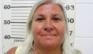 FILE - This file photo provided by the South Padre Island Police Department shows Lois Riess, of Blooming Prairie, Minn., who was arrested by federal deputy marshals Thursday, April 19, 2018, at a restaurant in South Padre Island, Texas. Riess pleaded guilty Tuesday, Dec. 17, 2019 to killing a Florida woman who prosecutors said was targeted because the two looked alike. Officials say Riess will serve a life sentence in prison for the first-degree murder of Pamela Hutchinson. (South Padre Island Police Department via AP)