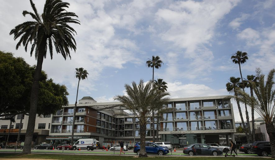 FILE - This May 6, 2019, file photo shows the Shore Hotel in Santa Monica, Calif. The beachfront hotel built without proper permits and fined nearly $15.6 million will be allowed to remain open. After hours of debate the California Coastal Commission voted 7-5 Thursday, Dec. 12, 2019, to approve after-the-fact permits for the Shore Hotel, the Los Angeles Times reported Friday. (AP Photo/Jae C. Hong, File)