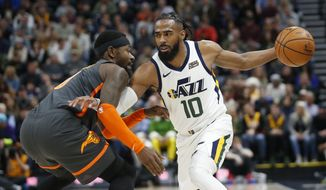Utah Jazz guard Mike Conley (10) drives around Orlando Magic guard Terrence Ross, left, in the second half of an NBA basketball game Tuesday, Dec. 17, 2019, in Salt Lake City. (AP Photo/Rick Bowmer)  **FILE**