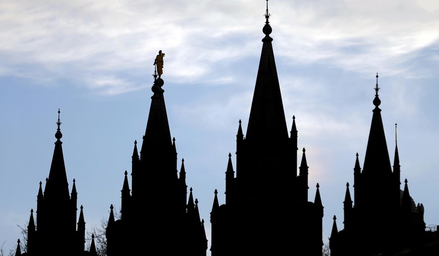 In this Jan. 3, 2018, file photo, the angel Moroni statue, silhouetted against the sky, sits atop the Salt Lake Temple of The Church of Jesus Christ of Latter-day Saints, at Temple Square, in Salt Lake City. (AP Photo/Rick Bowmer, File)