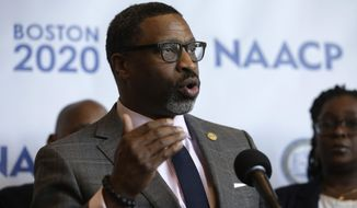 FILE - In this Thursday, Dec. 12, 2019 file photo, National Association for the Advancement of Colored People President Derrick Johnson faces reporters during a news in Boston, held to announce that the NAACP's 111th national convention is to take place in Boston, in July of 2020. Emails and recordings obtained by The Associated Press show that the NAACP's national president chastised women who went public with a sexual harassment claim. The records also show that Johnson was reluctant to swiftly deal with accusations against a former North Carolina officer in the civil rights organization. The emails also indicate that he knew about the complaint two years before he says he did. (AP Photo/Steven Senne, File)