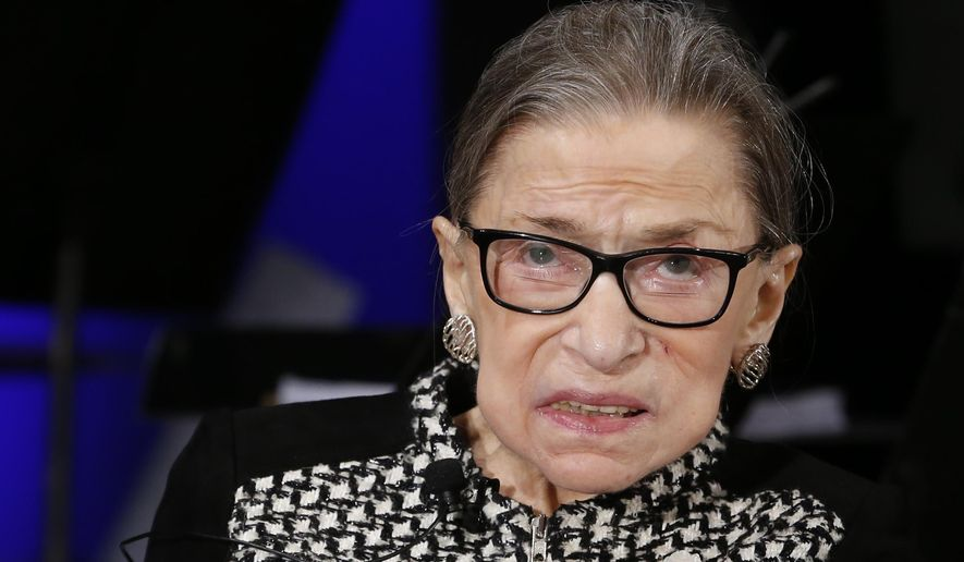 In this file photo, Supreme Court Justice Ruth Bader Ginsburg looks up as she speaks about the antics of her son as she speaks with author Jeffrey Rosen at the National Constitution Center Americas Town Hall at the National Museum of Women in the Arts, Tuesday, Dec. 17, 2019, in Washington. (AP Photo/Steve Helber) **FILE**