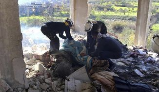 This photo released by the opposition Syrian Civil Defense rescue group, also known as White Helmets, which has been authenticated based on its contents and other AP reporting, shows Civil Defense workers searching in a house where six members of the same family were killed in shelling of the village of Bdama, in Idlib province, Syria, Tuesday, Dec. 17, 2019. Airstrikes and artillery shelling killed at least 11 civilians including six members of the same family amid intensified violence in rebel-held areas of northwestern Syria, opposition activists said Tuesday. (Syrian Civil Defense White Helmets via AP)