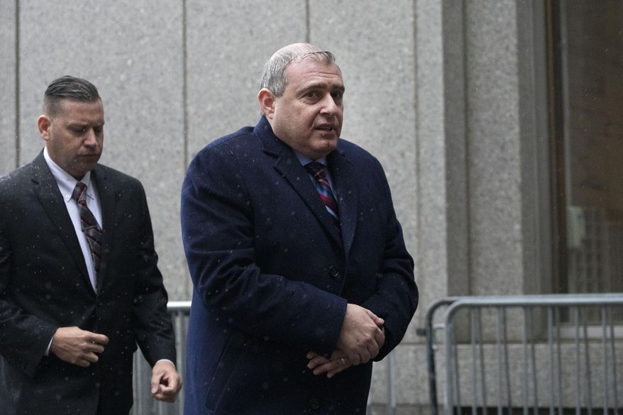 Lev Parnas, right, a Rudy Giuliani associate with ties to Ukraine, arrives for a bail hearing in federal court, Tuesday, Dec. 17, 2019 in New York. (AP Photo/Mark Lennihan) ** FILE **
