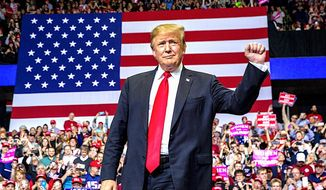 "President Trump blasted Democrats in public outreach to voters. He called it an ""impeachment scam."" Supporters have rallied around him. (Associated Press)"