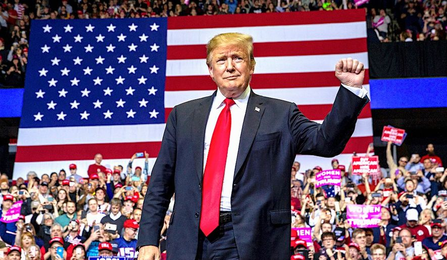 """President Trump blasted Democrats in public outreach to voters. He called it an """"impeachment scam."""" Supporters have rallied around him. (Associated Press)"""