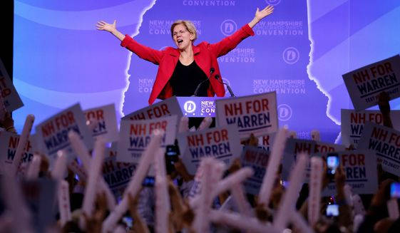 """""""And I believe America is going to say, 'We like Medicare for All,'"""" Sen. Elizabeth Warren said during a recent campaign stop in Iowa. (Associated Press photographs)"""