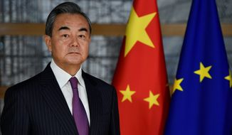 """China's Foreign Minister Wang Yi stepped up Beijing's war of words Friday. At a meeting, he labeled the U.S. the """"troublemaker of the world"""" and falsely accused the U.S. of having a hand in the Hong Kong protests. (Associated Press)"""