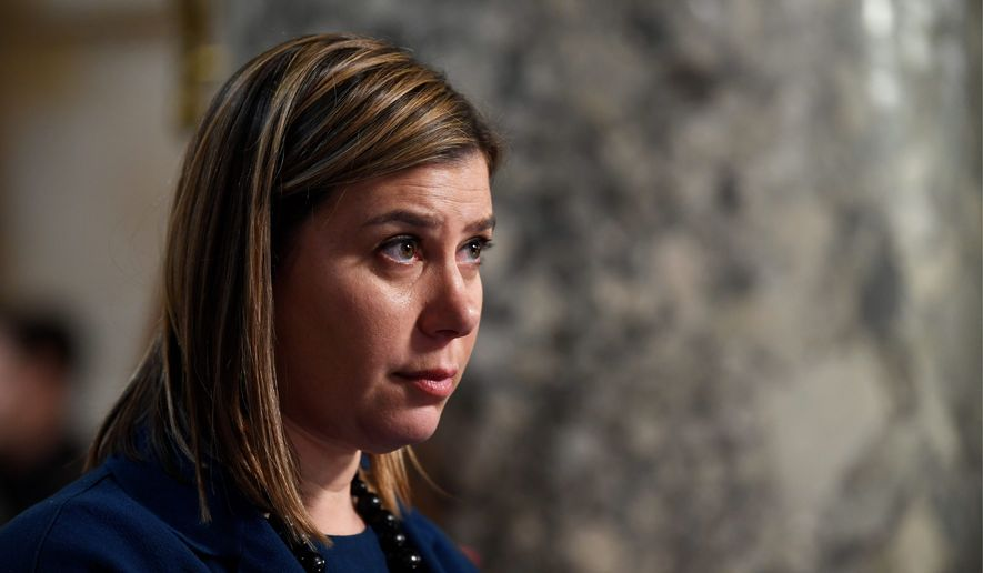 Rep. Elissa Slotkin, D-Mich., does a television interview on Capitol Hill in Washington, Wednesday, Dec. 18, 2019. (AP Photo/Susan Walsh) ** FILE **