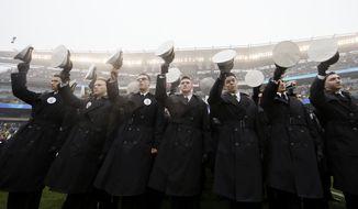 Navy midshipmen parade before an NCAA college football game against Army, Saturday, Dec. 14, 2019, in Philadelphia. (AP Photo/Matt Slocum) **FILE**