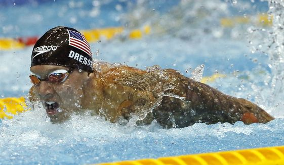 This Aug. 11, 2018, file photo shows U.S. swimmer Caeleb Dressel competing on his way to winning the men's 100m butterfly final during the Pan Pacific swimming championships in Tokyo.  In the post-Michael Phelps world, Dressel fits snugly into the successor's slot. Coming off two dynamic performances at the world swimming championships, Dressel figures to be one of the biggest stars at the 2020 Tokyo Games.  Yet he is reticent to step into the spotlight. (AP Photo/Koji Sasahara, File) **FILE**