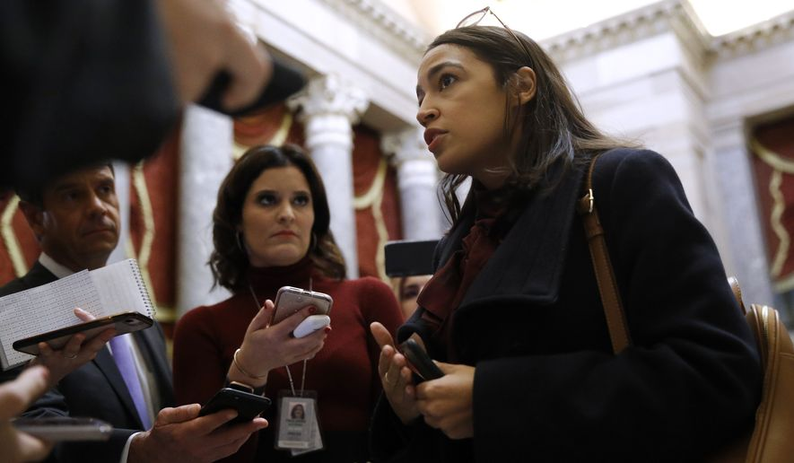 Rep. Alexandria Ocasio-Cortez, D-N.Y., speaks with reporters, Wednesday, Dec. 18, 2019, on Capitol Hill in Washington. President Donald Trump is on the cusp of being impeached by the House, with a historic debate set Wednesday on charges that he abused his power and obstructed Congress ahead of votes that will leave a defining mark on his tenure at the White House. (AP Photo/Patrick Semansky)