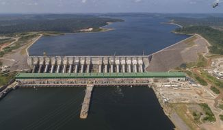 The Belo Monte hydroelectric dam stands in the Xingu River in Altamira, Para state, Brazil, Friday, Sept. 6, 2019. With the start of full-scale operations three weeks ago, debate over its legacy, and whether its construction was worth local sacrifice, is coming into focus. (AP Photo/Andre Penner)