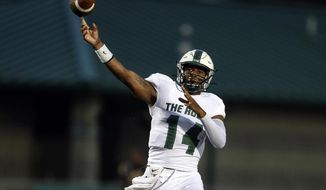 In this Sept. 21, 2019 photo provided by Slippery Rock University Athletics, Slippery Rock quarterback Roland Rivers III throws a pass during an during an NCAA college football game against Millersville in Slippery Rock, Pa. Rivers was selected to the first team of the Associated Press  Division II All-America football team, Wednesday, Dec. 18, 2019. (Slippery Rock University Athletics via AP)