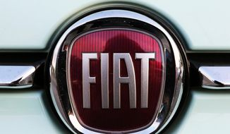 In this Oct. 31, 2019, file photo, a Fiat logo is pictured on a car in Bayonne, southwestern France. Fiat Chrysler Automobiles and PSA Peugeot announced Wednesday, Dec. 18, 2019, that their boards signed a binding deal to merge the two automakers, creating the world's fourth-largest auto company. (AP Photo/Bob Edme, File)