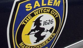 """FILE - In this Dec. 26, 2003, file photo, the logo for the Salem Police Department, which bears an image of a witch, is displayed on a police cruiser's door in Salem, Mass. The city's mayor said on Tuesday, Dec. 17, 2019, that President Donald Trump needs to """"learn some history"""" after Trump claimed those accused in the city's infamous 17th century witch trials received more due process than he has received in the House's impeachment inquiry. (AP Photo/Lisa Poole, File)"""