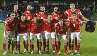 Russia national soccer team poses prior to the start of the Euro 2020 group I qualifying soccer match between San Marino and Russia, in San Marino, Tuesday, Nov. 19, 2019. (AP Photo/Marco Vasini)