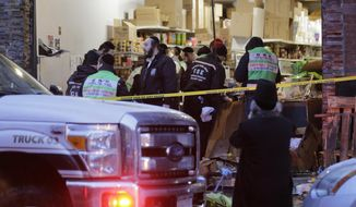 Emergency responders work at a kosher supermarket, the site of a shooting in Jersey City, N.J., Wednesday, Dec. 11, 2019. Jersey City Mayor Steven Fulop said authorities believe gunmen targeted the market during a shooting that killed multiple people Tuesday. (AP Photo/Seth Wenig) ** FILE **