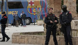 A bus carrying the Barcelona players leaves the Camp Nou stadium, ahead of a Spanish La Liga soccer match between Barcelona and Real Madrid in Barcelona, Spain, Wednesday, Dec. 18, 2019. Thousands of Catalan separatists are planning to protest around and inside Barcelona's Camp Nou Stadium during Wednesday's match against fierce rival Real Madrid. (AP Photo/Joan Mateu)