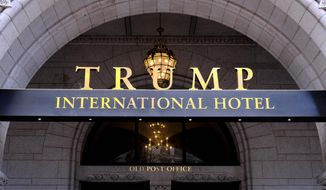FILE - In this March 11, 2019 file photo, the Trump International Hotel is seen in Washington.  In the weeks leading up to an invitation-only Republican fundraiser featuring an appearance by President Trump, room rates at the Trump International Hotel in Washington surged to as high as $6,719. That's more than dozen times the posted price for rooms on other weekends.  (AP Photo/Mark Tenally)