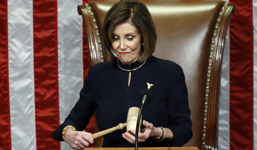 House Speaker Nancy Pelosi of Calif., holds the gavel after announcing the passage of the second article of impeachment, obstruction of Congress, against President Donald Trump by the House of Representatives at the Capitol in Washington, Wednesday, Dec. 18, 2019. (AP Photo/Patrick Semansky)