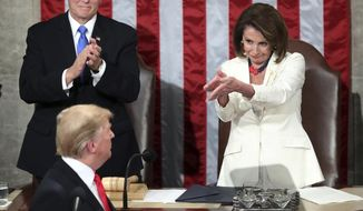 FILE - In this Feb. 5, 2019 file photo, President Donald Trump turns to House Speaker Nancy Pelosi of Calif., as he delivers his State of the Union address to a joint session of Congress on Capitol Hill in Washington, as Vice President Mike Pence watches. (AP Photo/Andrew Harnik)