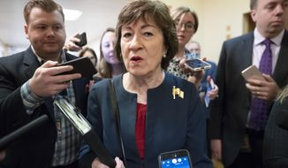 In this Nov. 6, 2019, file photo, Sen. Susan Collins, R-Maine, is surrounded by reporters as she heads to vote at the Capitol in Washington. U.S. Sen. Collins officially launched her bid for a reelection Wednesday, Dec. 18, setting up an expensive and closely watched battle for the seat the moderate Republican from Maine has held for nearly 24 years.  (AP Photo/J. Scott Applewhite, File)
