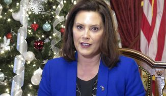 Michigan Gov. Gretchen Whitmer speaks about her first year in office and what is ahead during a roundtable with reporters, Wednesday, Dec. 18, 2019, in her ceremonial office at the Capitol in Lansing, Mich. Whitmer is working on a new road-funding plan after the Legislature rejected a proposed 45-cents-a-gallon fuel tax increase. (AP Photo/David Eggert)