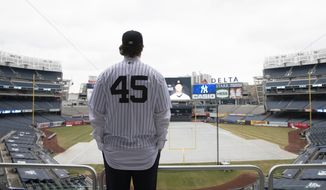 Gerrit Cole poses at Yankee Stadium as the newest New York Yankees player is introduced during a baseball media availability, Wednesday, Dec. 18, 2019 in New York. The pitcher agreed to a 9-year $324 million contract. (AP Photo/Mark Lennihan)
