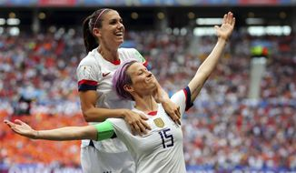 United States' Megan Rapinoe, right, celebrates after scoring the opening goal from the penalty spot during the Women's World Cup final soccer match between U.S. and The Netherlands at the Stade de Lyon in Decines, outside Lyon, France, July 7, 2019. (AP Photo/Francisco Seco)