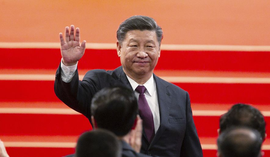 Chinese President Xi Jinping waves during the inauguration ceremony in Macao, Friday, Dec. 20, 2019, to mark the 20th anniversary of the former Portuguese colony's handover to Chinese rule. Beijing loyalist Ho Iat Seng was inaugurated Friday as China's chief executive in the tiny gambling enclave of Macao, which unlike neighboring Hong Kong has remained free of pro-democracy protests. (AP Photo) ** FILE **
