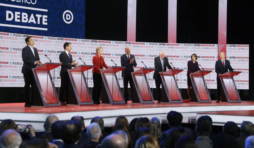 Democratic presidential candidates from left, entrepreneur Andrew Yang, South Bend Mayor Pete Buttigieg, Sen. Elizabeth Warren, D-Mass., former Vice President Joe Biden, Sen. Bernie Sanders, I-Vt., Sen. Amy Klobuchar, D-Minn., and businessman Tom Steyer participate in a Democratic presidential primary debate Thursday, Dec. 19, 2019, in Los Angeles. (AP Photo/Chris Carlson)