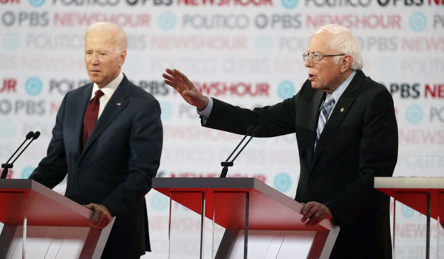 Democratic presidential candidate Sen. Bernie Sanders, I-Vt., right, speaks as former Vice President Joe Biden listens during a Democratic presidential primary debate Thursday, Dec. 19, 2019, in Los Angeles, Calif. (AP Photo/Chris Carlson)