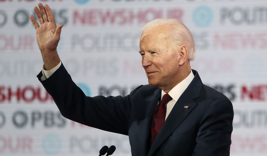 Democratic presidential candidate Former Vice President Joe Biden waves before a Democratic presidential primary debate Thursday, Dec. 19, 2019, in Los Angeles, Calif. (AP Photo/Chris Carlson)