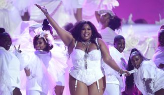 "Lizzo performs ""Truth Hurts"" at the BET Awards in Los Angeles on June 23, 2019. (Photo by Chris Pizzello/Invision/AP)"