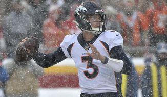 Denver Broncos quarterback Drew Lock (3) throws a pass during the first half of an NFL football game against the Kansas City Chiefs in Kansas City, Mo., Sunday, Dec. 15, 2019. (AP Photo/Ed Zurga)