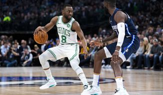Boston Celtics guard Kemba Walker (8) controls the ball as Dallas Mavericks guard Tim Hardaway Jr. (11) defends during the first half of an NBA basketball game Wednesday, Dec. 18, 2019, in Dallas. (AP Photo/Sam Hodde)