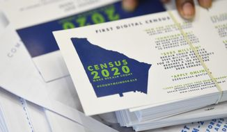 In this Aug. 13, 2019, file photo a worker gets ready to pass out instructions in how fill out the 2020 census during a town hall meeting in Lithonia, Ga. Facebook says it won't allow interference with the U.S. census on its platform, including posting misleading information about when and how to participate, who can participate and the consequences of taking part. (AP Photo/John Amis, File)  **FILE**