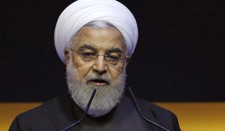 In this Thursday, Dec. 19, 2019, file photo, Iranian President Hassan Rouhani delivers a speech at the Kuala Lumpur Summit in Kuala Lumpur, Malaysia. Rouhani is to visit Tokyo to meet with Japanese Prime Minister Shinzo Abe later Friday, Dec. 20, 2019, in hopes of easing nuclear impasse between Tehran and Washington and relieving tension in the Middle East. Friday's visit is the first by an Iranian prime minister in 19 years and comes just before Japan is expected to announce a plan to deploy its troops to the Middle Eastern seas to ensure the safety of Japanese vessels transporting oil from the region. (AP Photo/Lai Seng Sin, File)