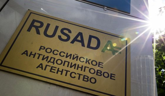 """This May 24, 2016 file photo shows a RUSADA sign that reads: """"Russian National Anti-doping Agency"""" on a building in Moscow, Russia. Russia is accused of manipulating an archive of doping data from a laboratory in Moscow, which was meant to be a peace offering to the World Anti-Doping Agency to solve earlier disputes. (AP Photo/Alexander Zemlianichenko, File)  **FILE**"""